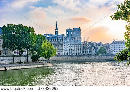 Cite Island With Notre Dame De Paris Cathedral At Sunset, Paris, France