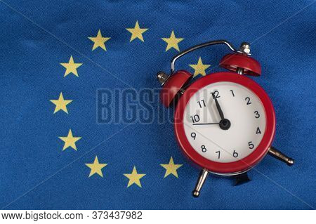 Eu Flag And Vintage Alarm Clock. Close Up. Time To Join The Eu.