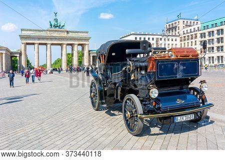 Berlin, Germany - May 2019: Black Retro Car With Brandenburg Gate (brandenburger Tor) At Background