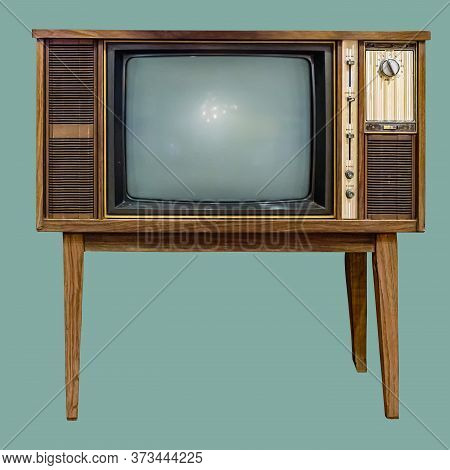 Vintage Tv : Old Retro Tv Set In Wooden Cabinet On Isolated Green Background With Clipping Path.