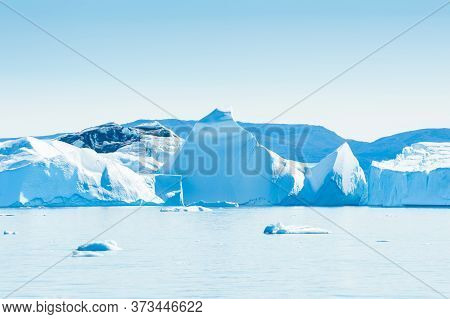 Big Blue Icebergs In Ilulissat Icefjord, Western Greenland, Atlantic Ocean.