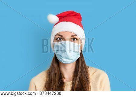 Caucasian Sad Woman With Medical Mask And Santa Hat. Christmas Alone On Quarantine