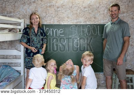 Portrait Of A Big Family At The Blackboard At Home School.