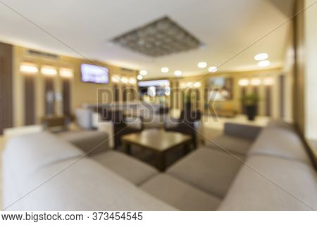 Blurred Photo Of Hotel Lobby With Big Heart Corner Sofa And Table