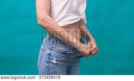Attractive Yoattractive Young Woman Wearing Jeans And Showing Slim Body After Sport Trainings And He