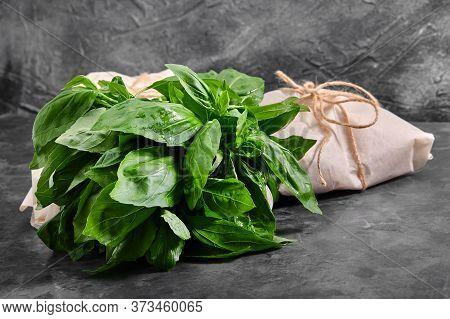 Fresh Basil On A Dark Background. Green Basil. Green Basil On A Dark Background. Food Background.