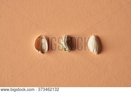 Pistachio Shell And Pistachio Isolated On Beige Background, Conceptual Photography For Food Blog Or