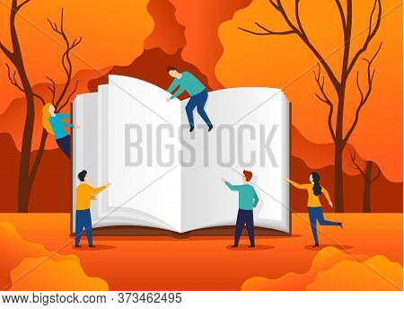 Textbook Studying Education - Autumn Book Festival Concept - Small People Reading An Open Hardcover
