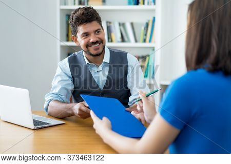 Laughing Latin American Businessman And Female Trainee At Job Interview At Office Of Start Up Compan