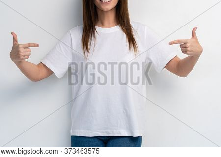 Portrait Of A Smiling Woman Holding Copyspace On The Palm Isolated On A White Background.