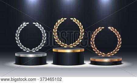 Stage Podium With Laurel Wreath. Golden, Silver And Bronze Stage Podium In Spot Light. Stage Podium