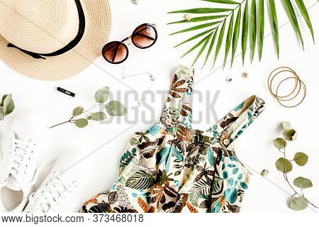 Female, Summer Street Style. Sundress-dress, Straw Hat, Sneakers, Sunglasses And Tropical Leaf. Top