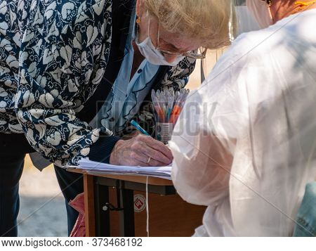 An Elderly Woman At A Street Polling Station To Vote On Amendments To The Constitution Of The Russia