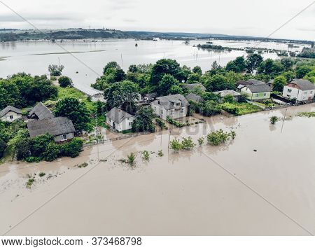 Climate Change And The Effects Of Global Warming. Flooded Houses, Streets, Farms And Fields After He