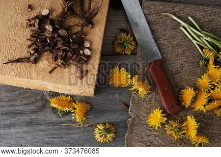 Shredded Roots And Flowers Of Dandelion On  Vintage Wooden Background With Copy Space, The Process O