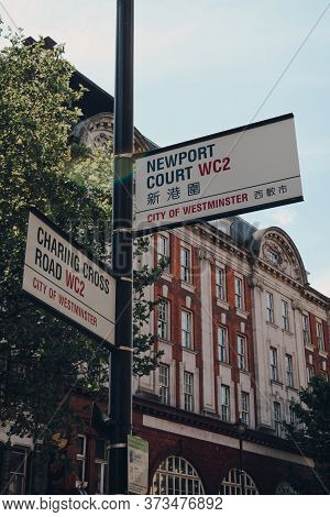 London,uk - June 13, 2020: Street Name Signs On Corner Of Charing Cross Road And Newport Court, City