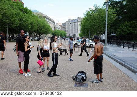 Washington Dc, Usa - May 02, 2019: Tourists Taking Photos From A Homeless Man In Front Of White Hous