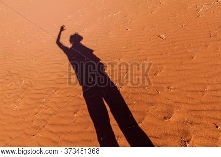 Shadow Of A Person In A Desert Dunes