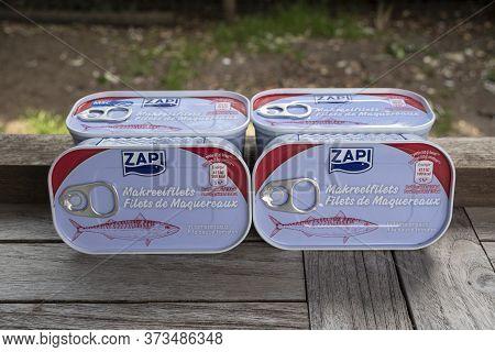 Sint Gillis Waas, Belgium, June 12, 2020, Four Tins Of Zapi Mackerel Fillet In Tomato Sauce