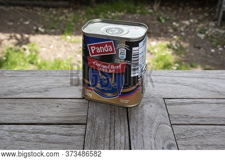 Sint Gillis Waas, Belgium, June 12, 2020, Tin Corned Beef From Panda Outside On A Wooden Table
