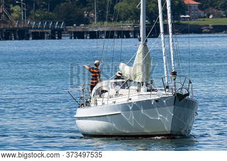 Bar Harbor, Maine, Usa - 28 July 2017: Sailboat In The East Side Waters Of Bar Harbor Using Its Moto