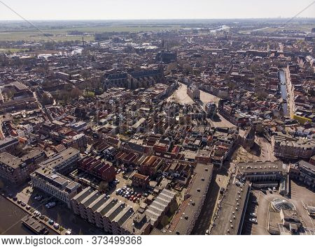 Aerial Drone Photo Of The Dutch City Gouda Where Gouda Cheese Is Made. City Center With Lots Of Hist