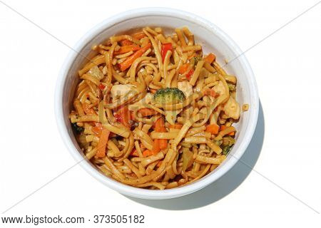 Sweet & Sour Chicken and Noodles. Home Made Sweet & Sour Chicken and Noodles dish in a White Ceramic Bowl. Isolated on white. Room for text.
