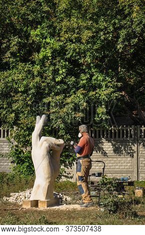 Pryluky, Ukraine - 09/14/2019: Sculpture Symposium, Creation Of The Monuments. Sculptors Creating Sc