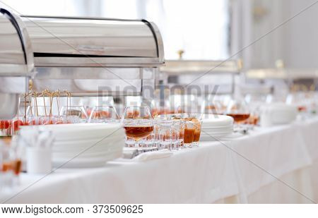 Catering Food On Table Glasses And Plates