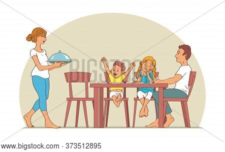 Happy Family With Two Children Gathered At The Table For Lunch. Mother Carries A Cooked Dish. Father
