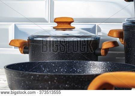 Close Up Photo Of Cookware Set On Kitchen Counter