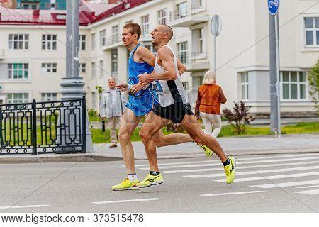 Ekaterinburg, Russia - August 6, 2017: Blind Man Athlete Runner Run With His Guide Runner In Europe-