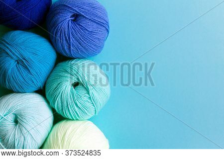 Acrylic Balls Of Yarn On A Blue Background. Nuance Color Combination. Skeins Are Located Vertically