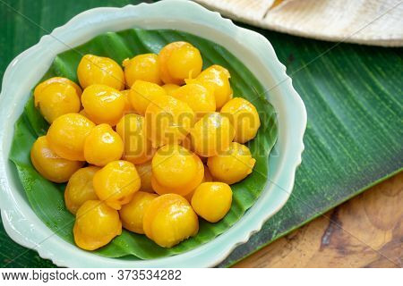 Kanom Thongyip And Thongyhod, Egg Yoke Fudge Balls Cooked In Syrup On Banana Leaf From Topview In Th