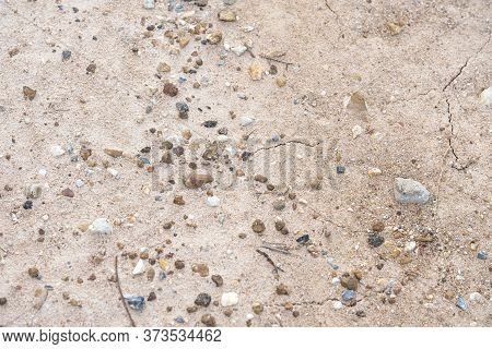 Fine And Coarse Gravels, Pepbles, And Small Pieces Of Rock Covering A Path Of Dried River Bed. Surfa
