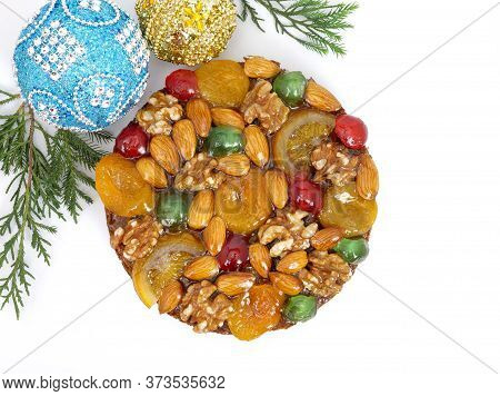 Traditional Fruitcake With Fruits And Nuts For The Holidays, Isolated On White Background