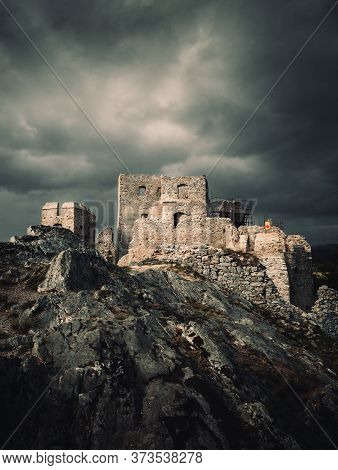 Dark And Moody View Of Hrusov Castle In Europe (slovakia) Before The Storm. Old Ruins Of Castle On T