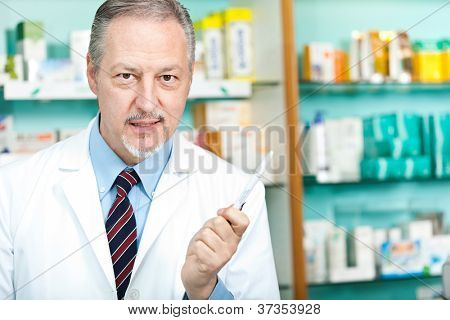 Portrait of a friendly chemist in his store poster