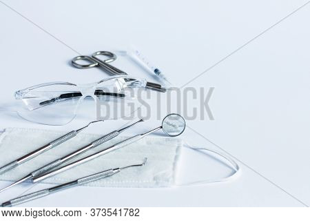 Dentistry Tools For Teeth Dental Care And Treatment On White Background. Professional Dental Instrum