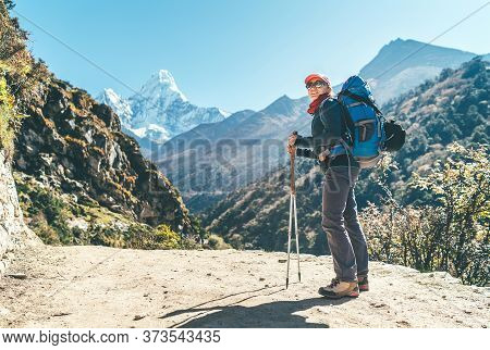 Young Hiker Backpacker Female Taking Photo Mountain View During High Altitude Acclimatization Walk.