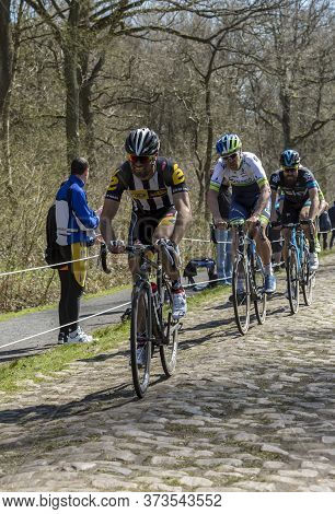 Wallers,france - April 12,2015: Three Cyclists, Reinardt Janse Van Rensburg Of Mtn-qhubeka Team, Jen
