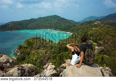 Koh Tao, Thailand - February 3, 2020: Tropical paradise island. Couple tourists enjoy view from John-Suwan Viewpoint