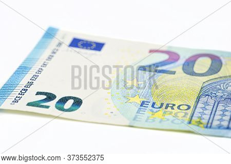 Macro Shot Of A European Union Banknote Of 20 Eur, Close-up Of The Number Twenty, Isolated On A Whit