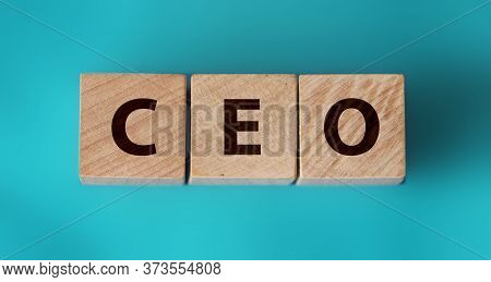 Woden Cube With Ceo Text Chief Executive Officer On Table Background. Financial, Marketing And Busin