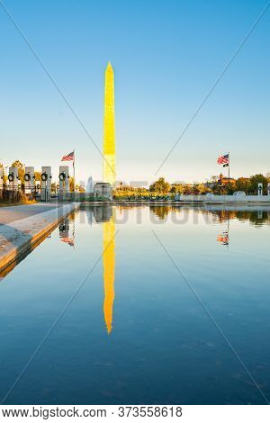 Washington Dc Usa - October 26 2014; George Washington Memorial Obelisk Standing Proud Catching Gold