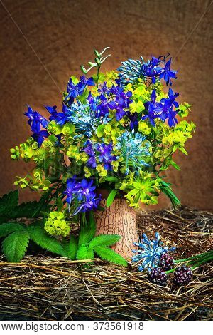 Rustic Still Life With Wildflowers On The Hay. Bouquet Of Yellow And Blue Wildflowers In A Vase. Nat
