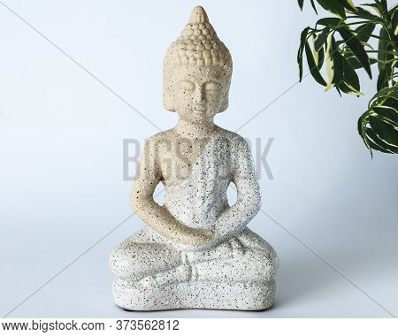 A Small Statue Of Buddha On White Background. Interior Solution.buddha Statue Used As Amulets Of Bud