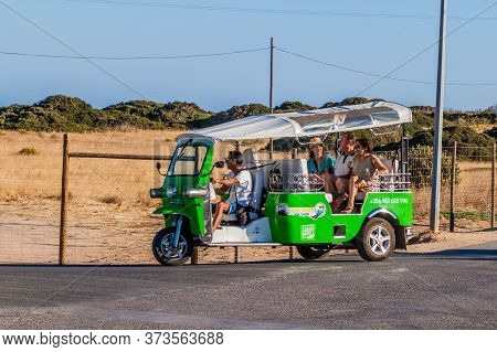 Lagos, Portugal - October 7, 2017: Tourists In A Tuk Tuk Vehicle Near Lagos, Portugal.