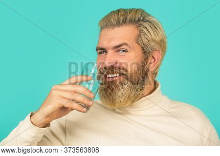 Bearded Man Drinking Water. Male Drinking From A Glass Of Water. Health Care Concept Photo, Lifestyl