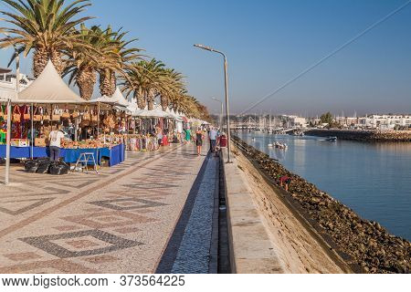 Lagos, Portugal - October 6, 2017: People Walk On A Riverside Promenade In Lagos, Portugal.
